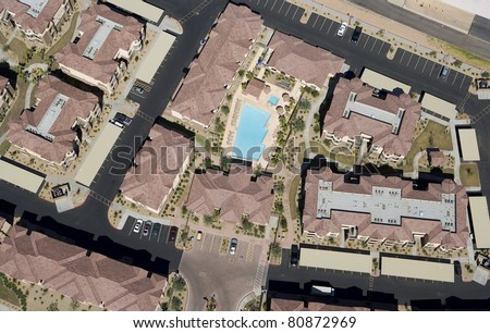 Apartment Complex Community with Swimming Pool from Above - stock photo