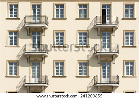 Apartment Complex Facade With Windows And Balconies - stock photo