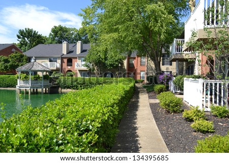 Apartment Complex on a Pond - stock photo