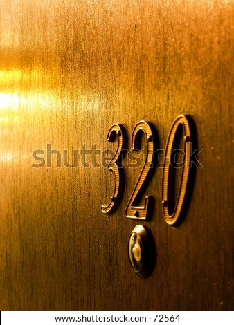 Apartment door with the number 320.