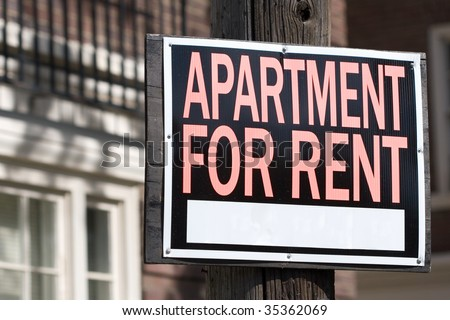 apartment for rent sign in front of an apartment building - stock photo