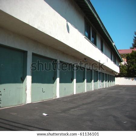 apartment garage doors in alley - stock photo