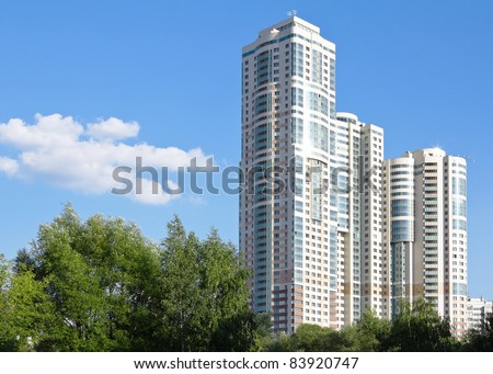 apartment house against the blue sky - stock photo