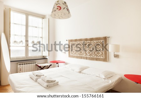 apartment in old building, interior, bedroom - stock photo
