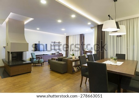 Apartment interior with fireplace - stock photo