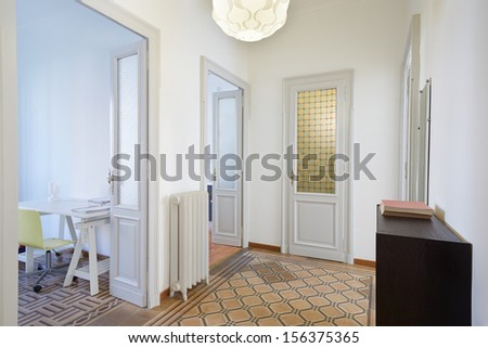 Apartment interior with hallway and rooms - stock photo