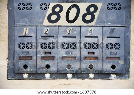 Apartment mailboxes with numbers in a big city - stock photo