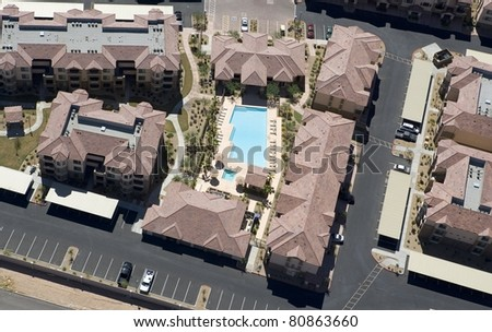 Apartment Rooftops and Swimming Pool from Above - stock photo