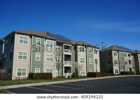 Apartment Building Roof solar building stock images, royalty-free images & vectors