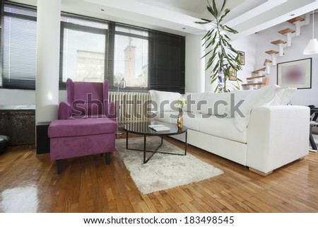 apartment with white and violet furniture - stock photo