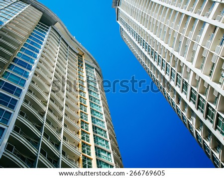 apartmentbuilding with blue sky - stock photo