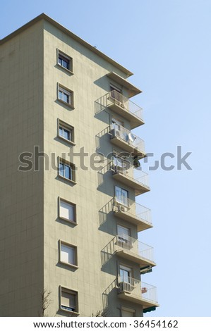 apartments building with blue sky - stock photo