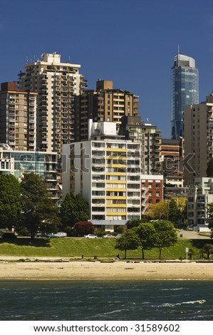 Apartments face the water and beach in the city. - stock photo
