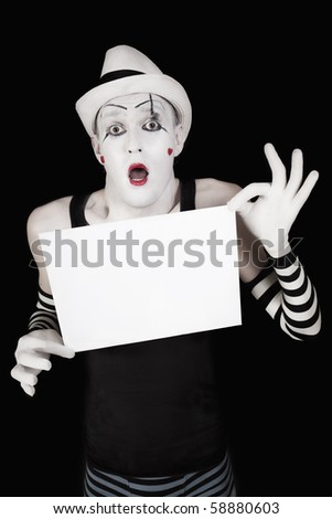 Ape mime in striped gloves and hat, holding a white blank - stock photo