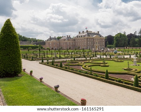 APELDOORN, NETHERLANDS - JUNE 14: View on palace Het Loo with visitors in the gardens on June 14, 2013. Built in the 17th century and now a tourist attraction it is still owned by the royal family. - stock photo