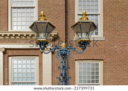 Apeldoorn, Netherlands - October 31, 2014: lanterns in front of Palace Het Loo in Apeldoorn. - stock photo
