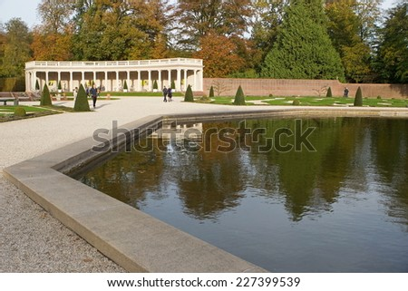 Apeldoorn, Netherlands - October 31, 2014: pavilion with pond in the park of Het Loo Palace in Apeldoorn and visitors. - stock photo