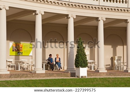 Apeldoorn, Netherlands - October 31, 2014: pavilion with visitors in the park of Het Loo Palace in Apeldoorn. - stock photo