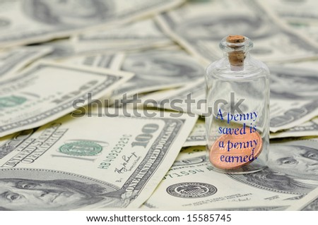 Apenny saved is a penny earned - penny in bottle over US 100 dollar bills - stock photo