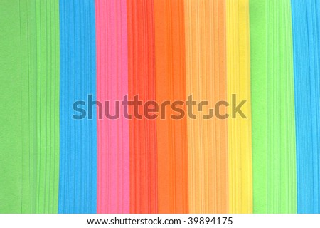 aper with bright strips lies on  white surface