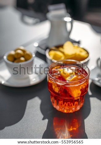 Aperol spritz cocktail with olive and orange piece as it can be served in Padua, Italy.