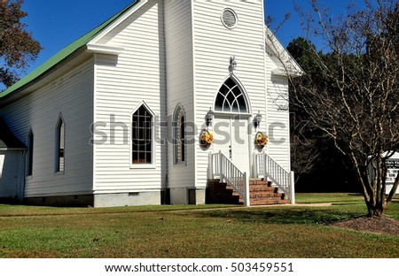 Apex, North Carolina - October 23, 2016: Entrance doorway to  historic Martha's Chapel Christian Church, a simple white clapboard structure dating to 1804