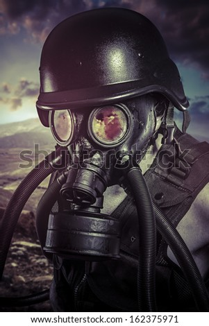 Apocalypse, nuclear disaster, man with gas mask, protection - stock photo