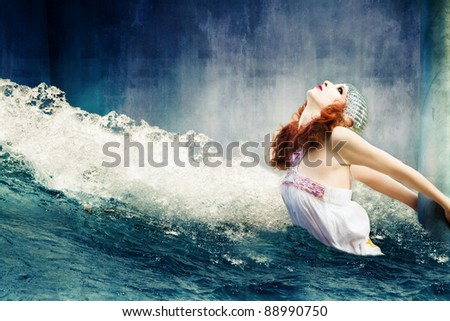 apocalyptic scene of flood with helpless  woman  hold on column - stock photo