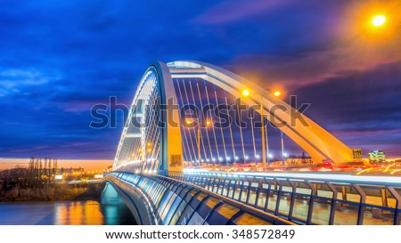 Apollo bridge in Bratislava, Slovakia with nice sunset and right part of river Danube, dramatic sunset with evening traffic lights - stock photo