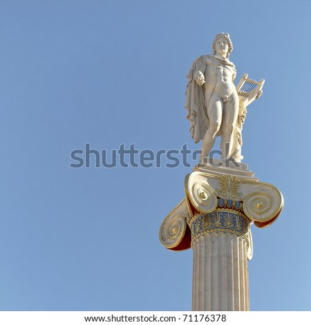 Apollo statue on Ionian column, space for type - stock photo