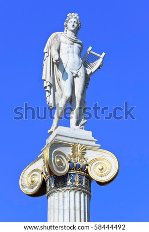 Apollo statue with golden decorations - stock photo