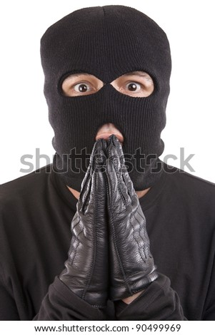apologizing thief with an expression of grief - stock photo