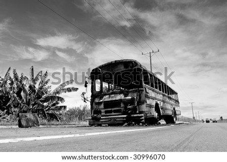 APOPA, EL SALVADOR. A city bus burned by gang members in Apopa, El Salvador. - stock photo