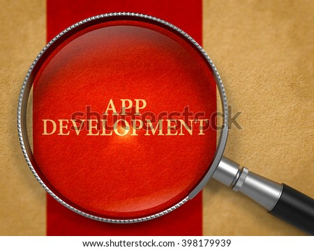 App Development through Loupe on Old Paper with Crimson Vertical Line Background. 3D Render. - stock photo