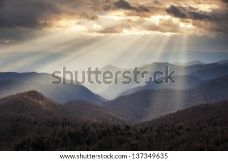 Appalachian Mountains Crepuscular Light Rays on Blue Ridge Parkway Ridges NC travel destination scenic in Western North Carolina - stock photo