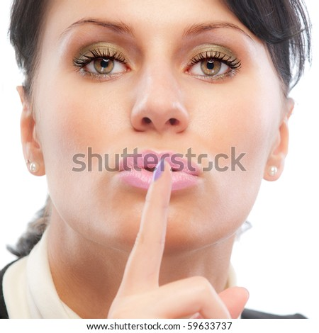 Appeal to silence. Beautiful girl puts forefinger to lips. Isolated on white background. - stock photo
