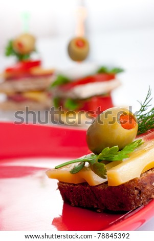 Appetiser sandwiches on a plate - stock photo