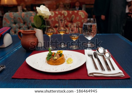 Appetizer and whisky on restaurant table - stock photo