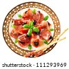 Appetizer (antipasto) of salami, Parma ham, olives and bread sticks. Isolated on white. - stock photo