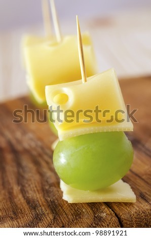 appetizer canape cheese with white grapes - stock photo