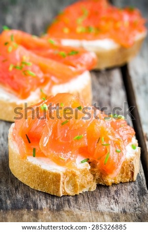 Appetizer canapes of baguette with smoked salmon, cream cheese - stock photo
