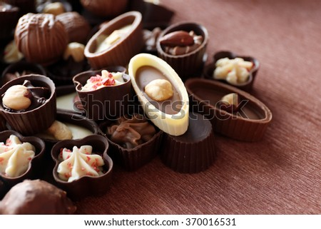 Appetizer chocolate candies on wooden background - stock photo