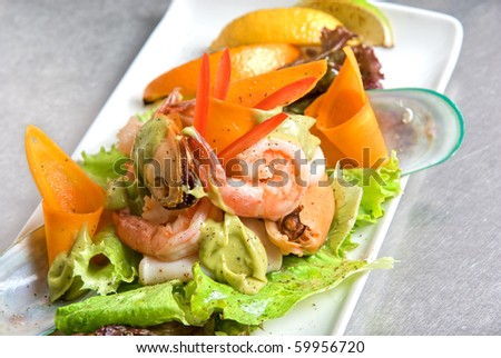 appetizer closeup dish of seafood and vegetables - stock photo