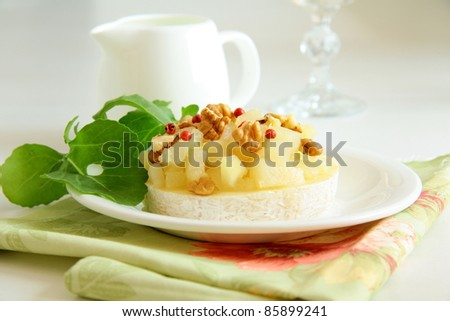 appetizer delicacy of pears and cheese Camembert - stock photo