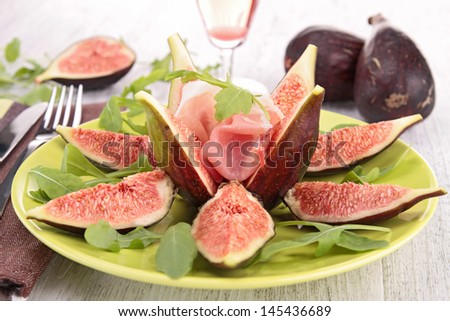 appetizer, fig salad with proscuitto ham - stock photo