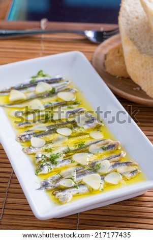 Appetizer - Fish Carpaccio on white dish
