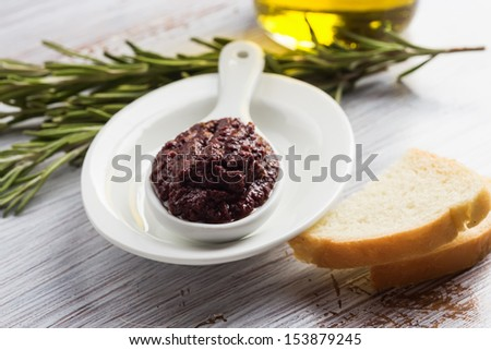 Appetizer from olives . Tapenade. On white wooden background. Selective focus. - stock photo