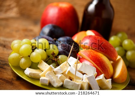 Appetizer mix including cheese, grape, plum and apple - stock photo