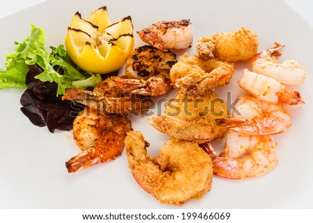 Appetizer of fried, grilled, and blackened shrimp. - stock photo
