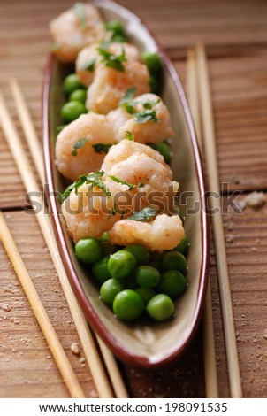 appetizer of fried shrimp and peas on the table